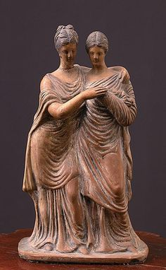 Two women standing        Terracotta        Height - 25.2 cm        IV century BC. e.        Tanagra Inv. Number 335