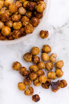1 can (14 oz) chickpeas (garbanzo beans), drained   2 teaspoons olive oil  1 teaspoon cinnamon or your spice(s) of choice  1 1/2 teaspoons brown sugar  1/4 teaspoon salt  Place chickpeas on a baking sheet lined with parchment paper or a Silpat.  Bake at 450 F for 30 minutes. (You didn't miss anything here.  You don't oil or season them until after they are done.