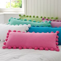 pottery barn pillows, but how cute and easy to make! what kid wouldn't love to jump on a pile like this? i sure would.
