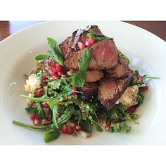 How delicious does this look? TODAY'S SPECIAL: Marinated Lamb Backstrap with quinoa roquette feta mint and pomegranate salad! by pavilioncafebar http://ift.tt/1LWgNOG