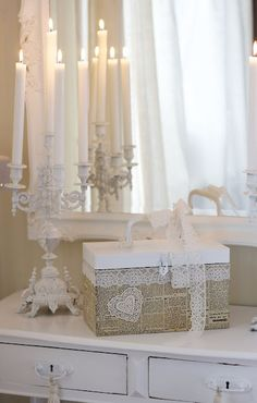 Pretty vignette, love the lace adorning the box~❥