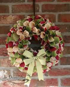 Christmas Paper Wreath - shut the front door! Do you have any idea how much Christmas paper I have? :)