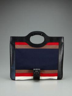 L.A.M.B. Dakota Convertible Clutch. I have this one in a black & white stripe. Love it!