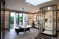 Words cannot describe the awesomeness of this bathroom. The tiles, the bathtub, the windows, the shower.