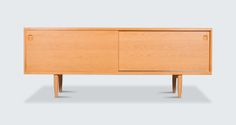 Sideboard by Niels Moller - Sophisticated model 20 sideboard by Niels O. With internal drawers and shelving offering abundant and versitile storage. An exceptional design piece that will elevate any room. Vintage Furniture, Furniture Design, Pop Up Shops, Australian Art, Modern Times, Contemporary Furniture, Sideboard, Shelving, Restoration
