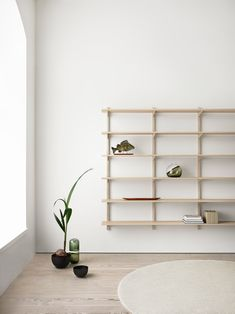 Cate&Nelson's contribution is a wall mounted shelf system. Designed to be easy to assemble without the use of screws, it is made in American ash with concealed hanging.