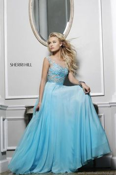 Sherri Hill A Line Dress comes in all these colors: Aqua/Nude, Black/Nude, Coral/Nude, Emerald/Nude, Ivory/Nude, Navy/Nude, Nude/Nude, Periwinkle/Nude, Pink/Nude, Red/Nude, Royal/Nude, Silver/Nude