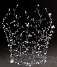 Looks like a crown, but is actually a wedding cake topper! Fabulous. I'd love to see it on the cake!  From: Alice Cicek