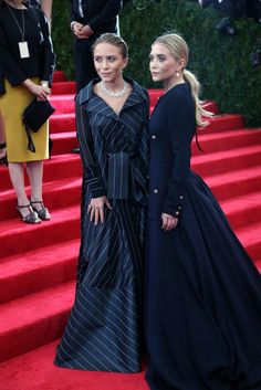 Mary-Kate and Ashley Olsen in vintage black dresses at Lily et Cie in Beverly Hills at the Met Gala