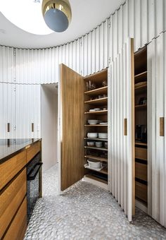 Built-in kitchen cabinets with interior in beautiful wood.