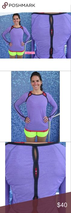 """Lululemon Run Team Spirit Power Purple Open Back 4 📡PRICE IS FIRM AND NON-NEGOTIABLE. NO OFFERS. LOWBALLERS WILL BE BLOCKED. NO TRADES.📡 Lululemon """"Run: Team Spirit LS"""" top in Power Purple, size 4. Made of anti-bacterial/anti-stink Silverescent fabric, with Luxtreme trim on the neck and arms. Reflective details to keep you visible in low light. Thumbholes. Soft and stretchy. lululemon athletica Tops Blouses"""