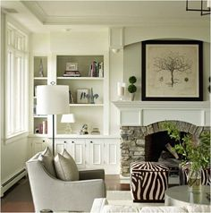 Love these built-in bookshelves, the stone work, and the ZEBRA ottoman! Bella Mancini Design via Centsational Girl.