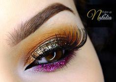 What a vibrant look by Natalia Piotrowicz! She used Makeup Geek Eyeshadows in Bitten, Chickadee, and Corrupt + Makeup Geek Gel Liner in Immortal + Makeup Geek Pigments in Utopia and Vegas Lights.
