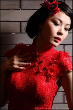 """Elton John – """"Can you feel the love tonight""""  EGRD05 - A trendy bright red lace Qi Pao with floral applique around cap sleeves.  Finishing with a high split and scalloped lace train.  #wedding #evening #dresses #gowns #bridal #lace #qipao #lune #lunewedding"""