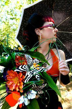 I like this photo because:  Awesome parasol  Pretty dress  Love her hair  DUCK TAPE FLOWERS!