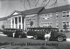 1931 photograph of children getting into a school bus.  I wonder what color the bus is...it doesn't look yellow! (Georgia Historical Society)