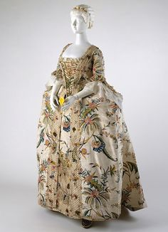 This image is from the metropolitan museum of art it shows a Robe a la Francaise this dress is made of silk and linen and has petticoats underneath the dress has a stomacher in the middle that is held in by laces.
