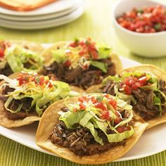 BEEF TOSTADAS: ~ This Tostada  recipe is prepared in the slow cooker. Layer the beef with your favorite fixings on warm tortilla shells to finish off the main dish.