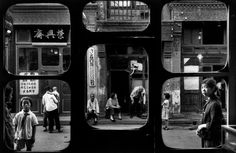 A street in Beijing as seen from inside an antique dealer's shop. China. 1965. Photo by Marc Riboud #street