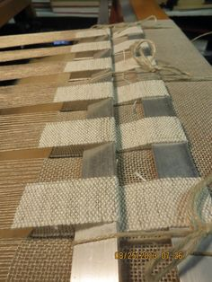 I have had a few requests to show how these pieces are woven.  The flaps are woven as I weave the groundcloth and then they are incorporated...