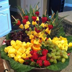 Party Fruit Tray. This has the wow factor of a fruit bouquet with a lot less effort. I flipped the orange peel side up and just sliced off a bit to make it sit flat. Since it was for Easter I topped the kabobs with colored peeps. Will definitely make again someday.