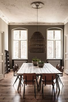 dining room with focus on earthy natural materials, including hand woven pendant lamp.