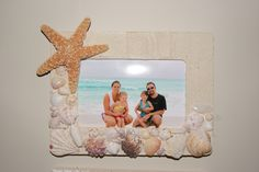 "I picked all the shells I wanted while on vacation, got some sand, bought some star fish and came home.  I got the wooden picture frame from Micheales (US = Joannes) and set to work.   I brushed elmers white glue over the board and sprinkled sand over top, gave it a pad and let dry.  Then I positioned my shells where I wanted them and then set to work with a hot glue gun.  VIOLA! A perfect way to display a great memory, and a use for my ""treasures!"""
