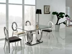 high table and chairs made of glass