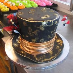 3D Top Hat Mad Hatters shaped cake with bronze ribbon by Charly's Bakery