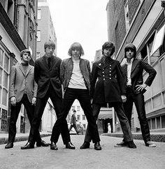"The Yardbirds, 1966 ""This session captures the band with both Jimmy Page and Jeff Beck, who many considered to be the finest British rock guitarists of this time. I shot this just outside my studio and it was pure luck that in the background you can see the symbol of the British establishment striding past wearing his bowler hat, snapped between the legs of singer Keith Relf."""