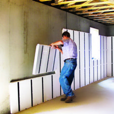 Installing Insulation Panels on A Wall InSoFast insulating basement walls - Basement Insulating Basement Walls, Basement Wall Panels, Drop Ceiling Basement, Finishing Basement Walls, Basement Insulation, Drywall Ceiling, Wall Insulation, Alternatives To Drywall, Finished Garage