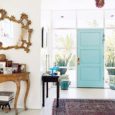 Painting the inside of the front door is a good way to add a pop of color to your home. (via apartmenttherapy)
