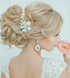 Beautiful, soft, loose up do, for a beautiful bride.