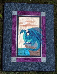 Small Majestic Dragon Quilt with Celtic Knotwork Border. $300.00, via Etsy.