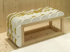 semicircular bench in marble and wood by patricia urquiola with budri: nat(f)use for marmomacc