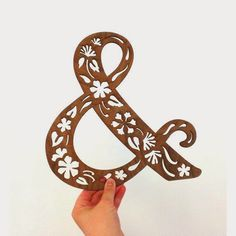 Above is a laser cut walnut wood ampersand from Alexis Mattox Design.