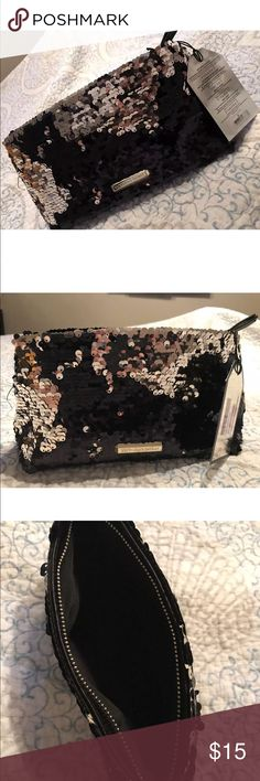 NWT Victoria Secret Sequin Makeup Bag Reversible Brand New Victoria Secret Sequin Makeup Bag-Black/Gold Reversible Could also be used as a clutch Victoria's Secret Bags