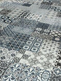 PARADOR - Lames stratifiées à clipser - motif carreaux de ciment gris.