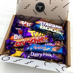 A Selection box of 12 British Cadbury chocolate bars packaged ready for shipping worldwide