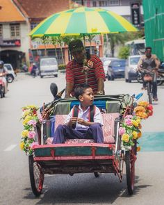 To School George Town Style  #streetphotography #Travelphotography #trishaw #GeorgeTown #Penang  #Commute #GeorgeTownToday  #unesco #PulauPinang #streetphotographers #gspc #onthestreets #streetlife #travel #sailing #world  #ig_streetphotography #lensculturestreets #oneworld