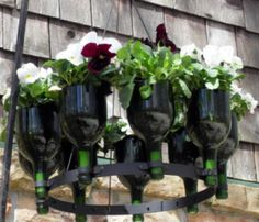 DIY Wine Bottle Gardens--it almost looks like a chandelier.