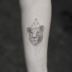 Lioness head tattoo by @maredelanoir.nyc