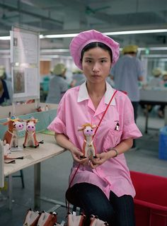 """""""The Real Toy Story"""" is a photo series from 2006 by Hong Kong-based photographer Michael Wolf that features images of Chinese toy factory workers and Wolf Photography, Portrait Photography, Photography Office, Colour Photography, Street Photography, Toy Story, Michael Wolf, Foto Portrait, Factory Worker"""