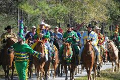 Costumed courir riders make their way between stops outside Elton, La., during a recent Mardi Gras. The man walking at left wears a traditional pointed hat known as a capuchin.
