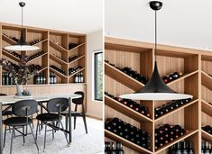 The wine storage wall, which is made from wood, includes lower cabinets, a countertop, and a shelving unit with a chevron design. Built In Dresser, Ceiling Storage, Grey Countertops, Study Nook, Shower Niche, Low Cabinet, Grey Tiles, Wood Vanity, Wine Storage