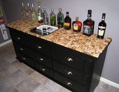 Repurposed dresser into bar table with wine cork top. Cool idea!