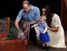 The Most Uplifting Photos of 2014.  Dutches Catherine, husband Prince William and son Prince George. 4/20/2014..