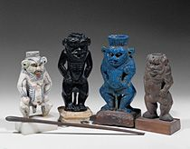 Vessels for kohl (eyeliner) in the form of the god Bes. H: 8,5 cm, 9cm,