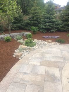 Extension of the Armor stone and Hemlock mulch on display at the Prestige Landscaping Job. Oaks Rialto in Champagne