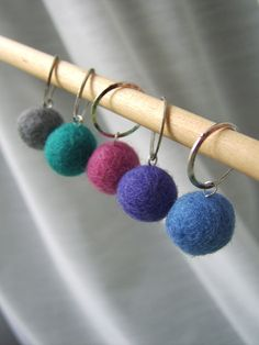 Felted wool stitch markers from LadyDanio on Etsy.